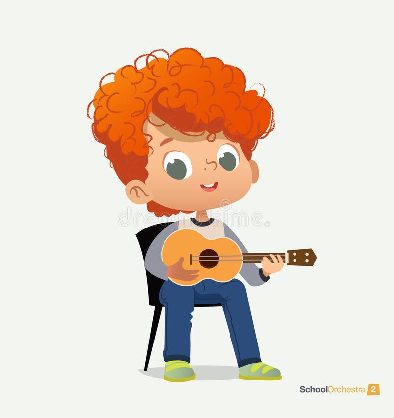 Free Curly Red-haired Boy Sit On Chair Play Guitar Royalty Free Stock Image - 144095806