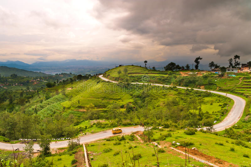 Curly Road with green field in Nepal royalty free stock photography