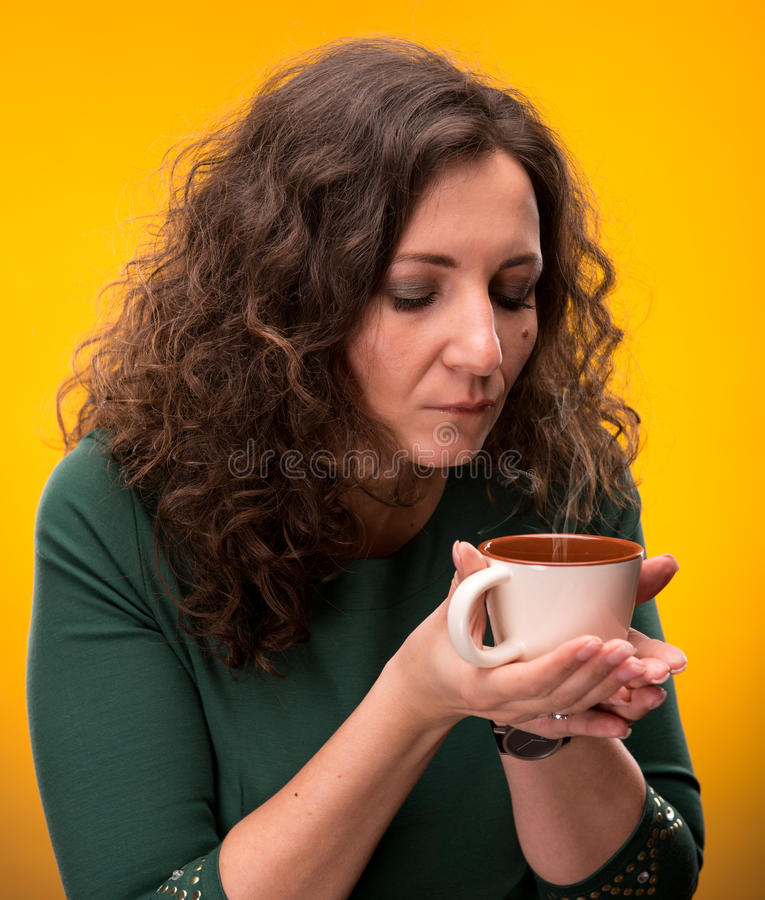 Download Curly Woman With A Cup Of Tea Or Coffee Stock Images - Image: 29586304