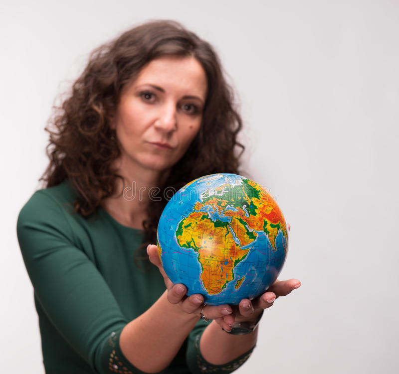 Download Curly Woman Holding A Globe Stock Image - Image: 29586153