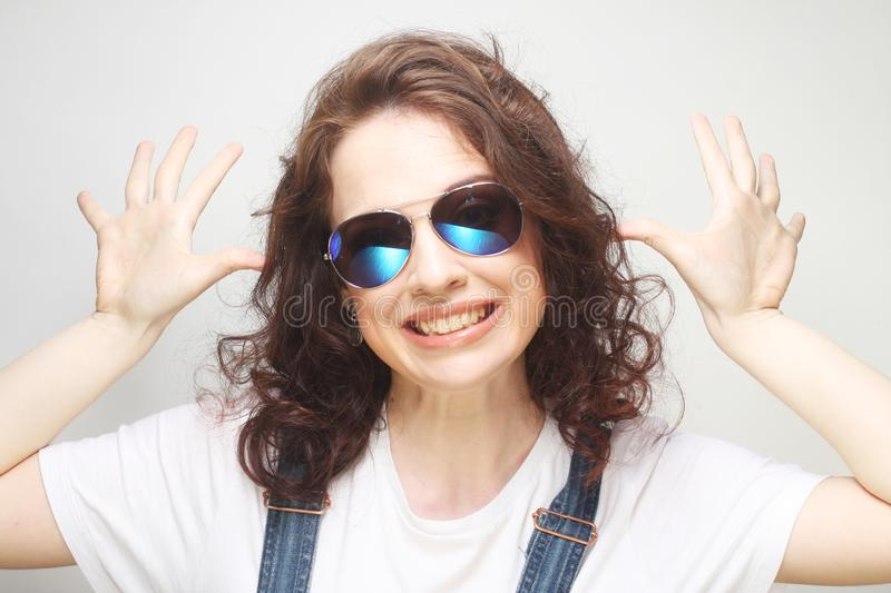 Curly woman with sunglasses. Funny curly woman with sunglasses, emotional picture royalty free stock image