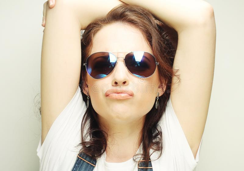 Curly woman with sunglasses. Funny curly woman with sunglasses, emotional picture royalty free stock images