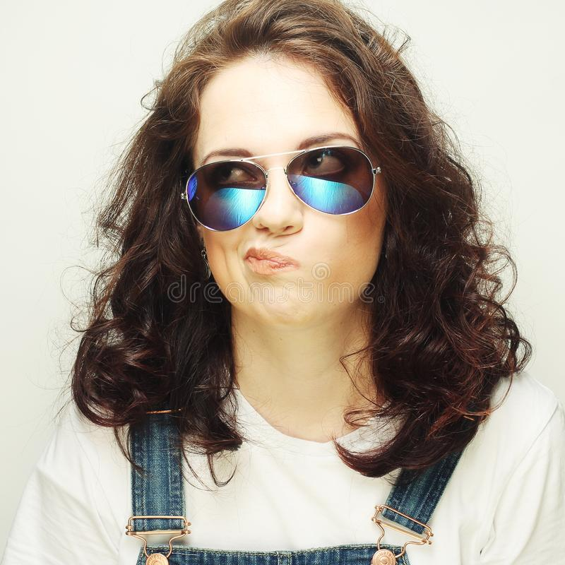Curly woman with sunglasses. Funny curly woman with sunglasses, emotional picture stock photos
