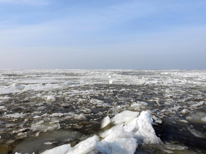Curonian spit in spring with ice pieces, Lithuania. Sunny day and Curonian spit with ice pieces in spring royalty free stock photo