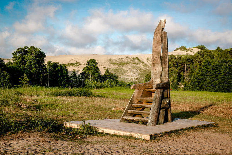Curonian Spit. Wooden chair in the Curonian Spit. Nida resort town. Neringa, Lithuania royalty free stock images