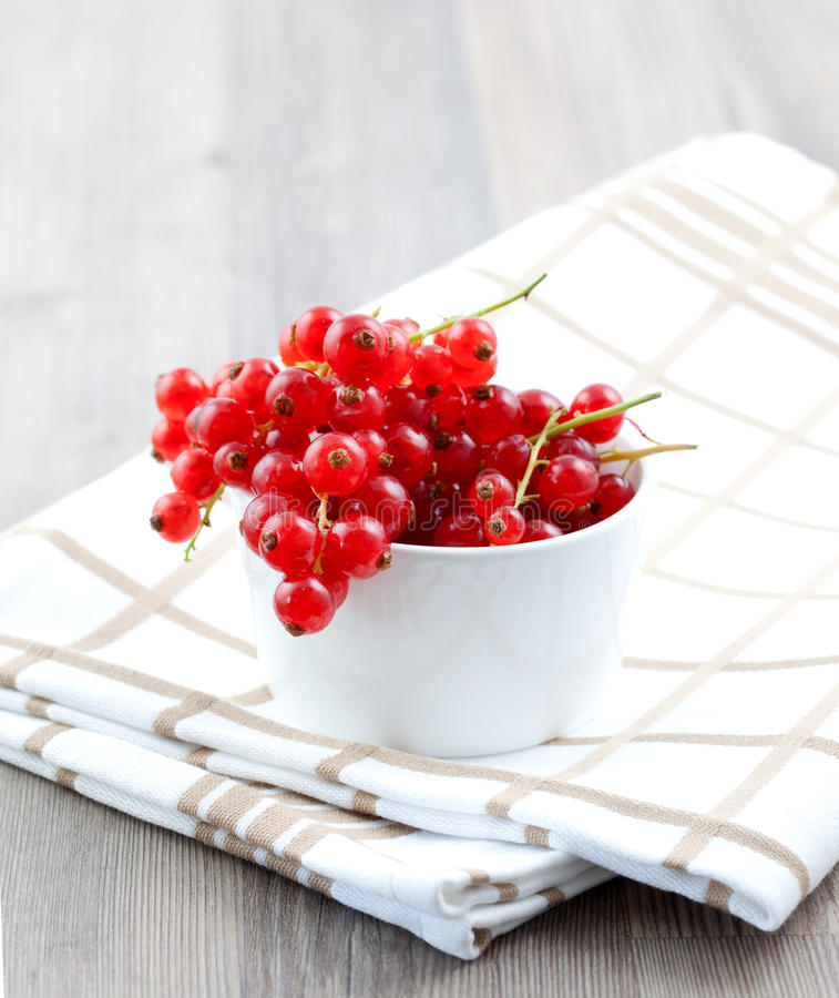 Currant in bowl. On dishtowel stock photo