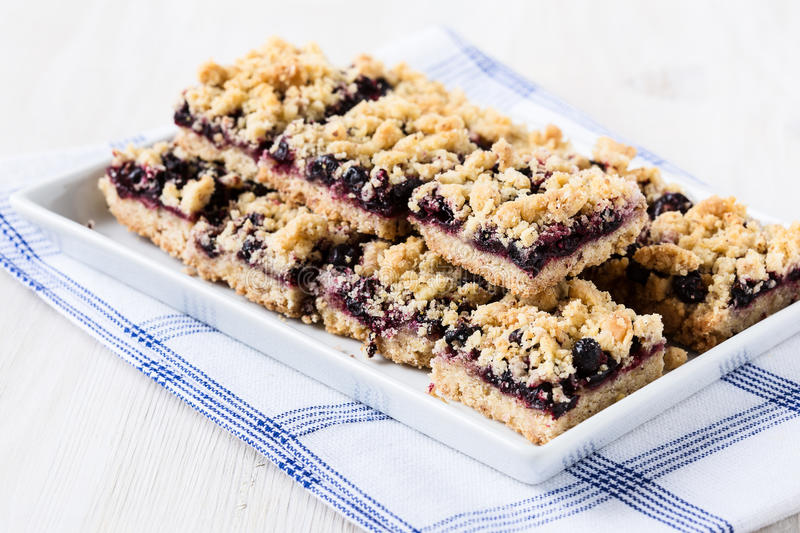 Currant cornmeal crumble bars. Homemade currant cornmeal crumble bars with streusel topping, healthy sweet dessert royalty free stock images