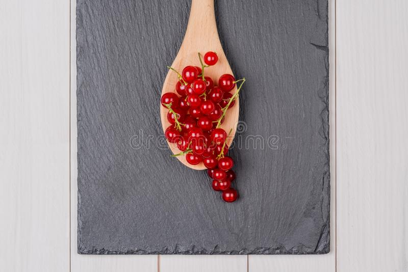 Currants in a wooden spoon stock images
