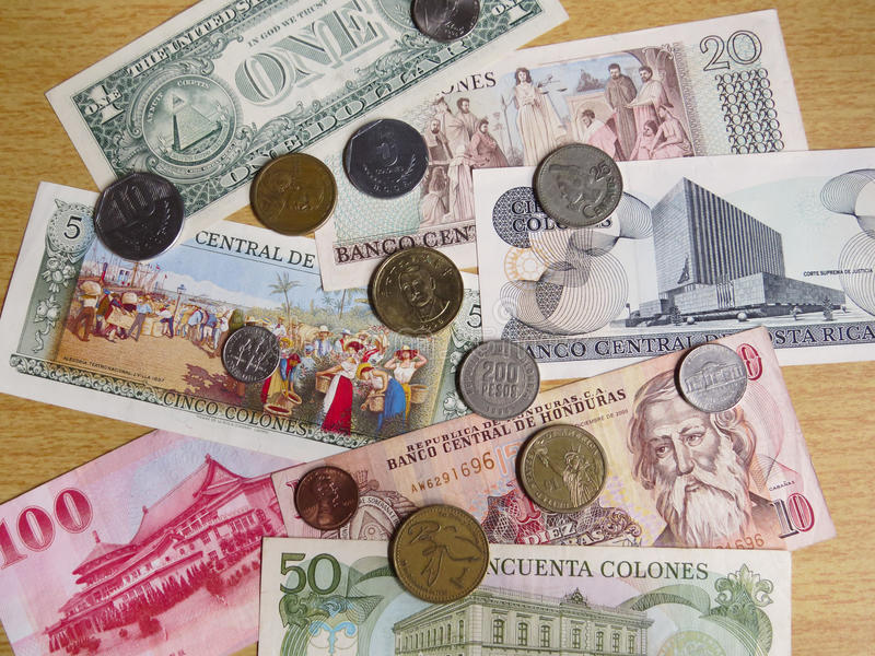 Currencies from around the world. Paper money and some coins from some countries around the world royalty free stock images