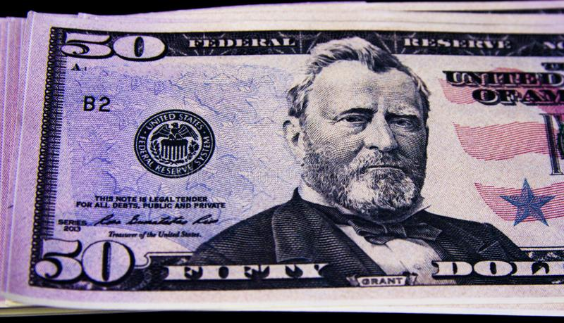 Currency American dollars on a black background royalty free stock photography