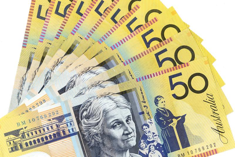 Currency banknotes spread across frame australian dollar. Notes royalty free stock photography