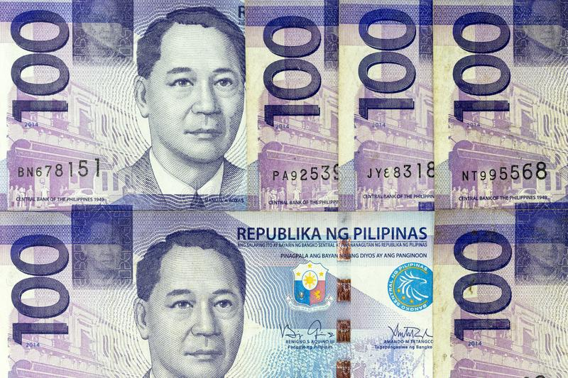 Currency banknotes spread across frame philippines peso stock photo