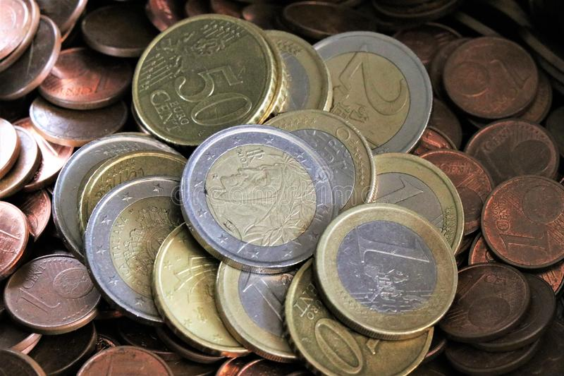 Currency of the European Union. Pile of Euro coins. Stack of Euro coins. Pieces of Euro cents royalty free stock photography