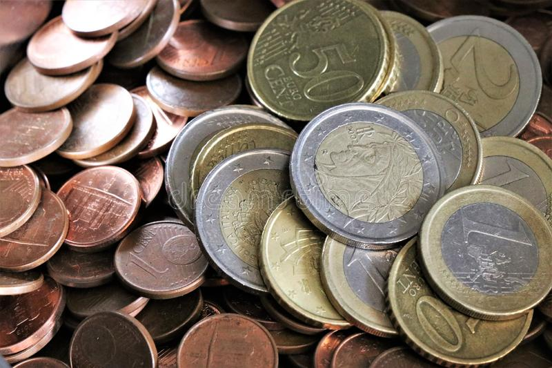 Currency of the European Union. Pile of Euro coins. Stack of Euro coins. Pieces of Euro cents royalty free stock photos