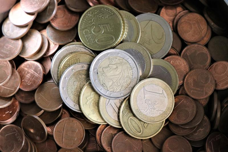 Currency of the European Union. Pile of Euro coins. Stack of Euro coins. Pieces of Euro cents stock photos