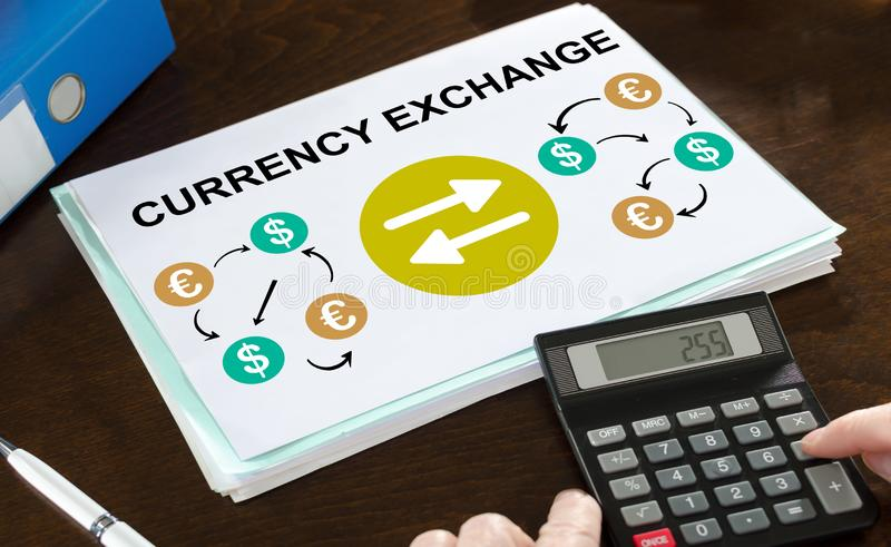 Currency exchange concept illustrated on a paper. With a calculator stock photo