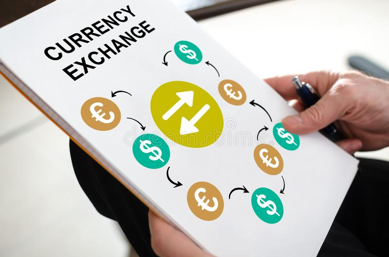 Currency exchange concept on a paper. Held by a hand royalty free stock photos
