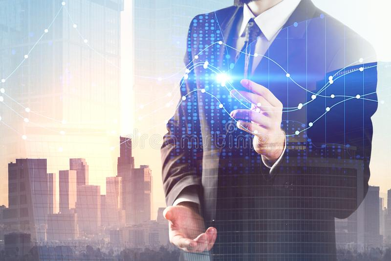 Currency exchange and trade concept. Businessman pointing at glowing forex chart on abstract city background. Currency exchange and trade concept. Double stock image