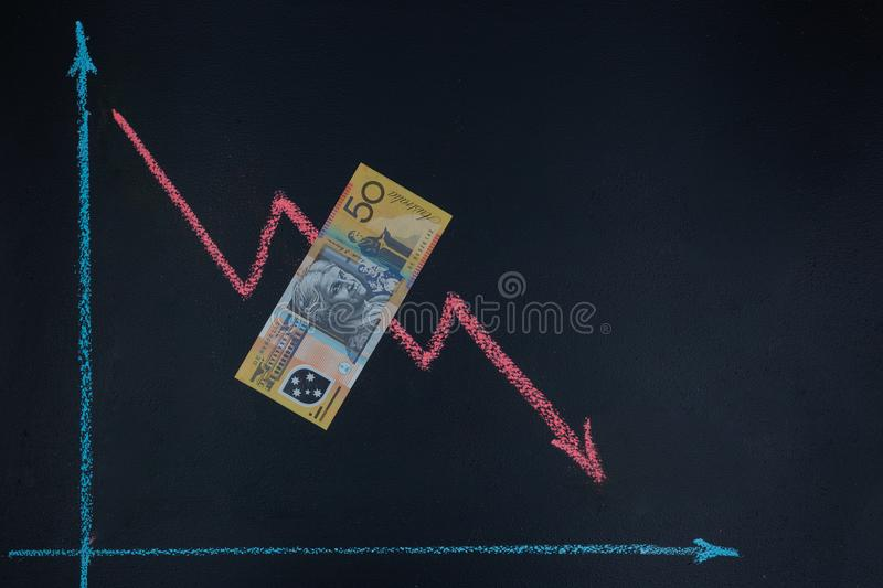 Currency forex trends market concept. Currency forex trends market concept - decreasing trend depicted with line graph pointing down drawn with chalk on royalty free stock photography