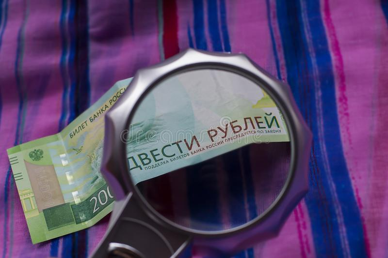 Currency new rubles, banknotes nominal 200. Macro image. Banknote of two hundred Russian rubles, detail. Paper currency of Russia royalty free stock photos