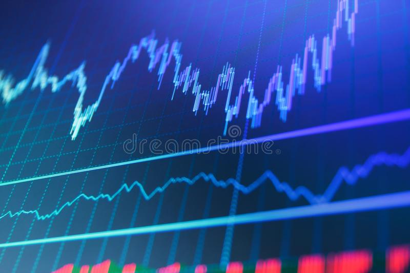 Currency trading theme. Stock market graph on the screen. royalty free stock image