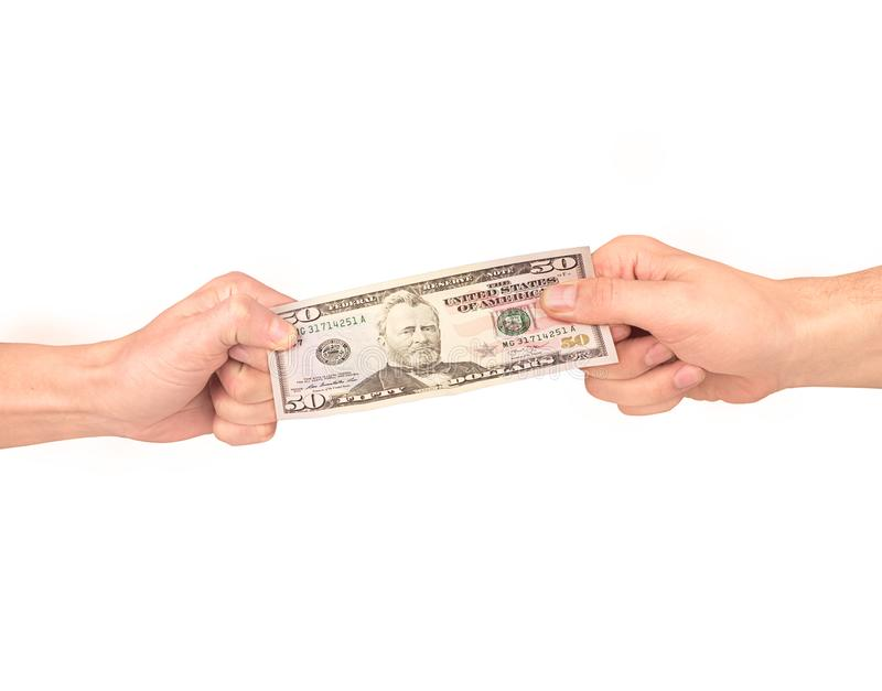 Currency tug-of-war concept for business rivalry. Two businessman fighting over dollar bill. royalty free stock photography