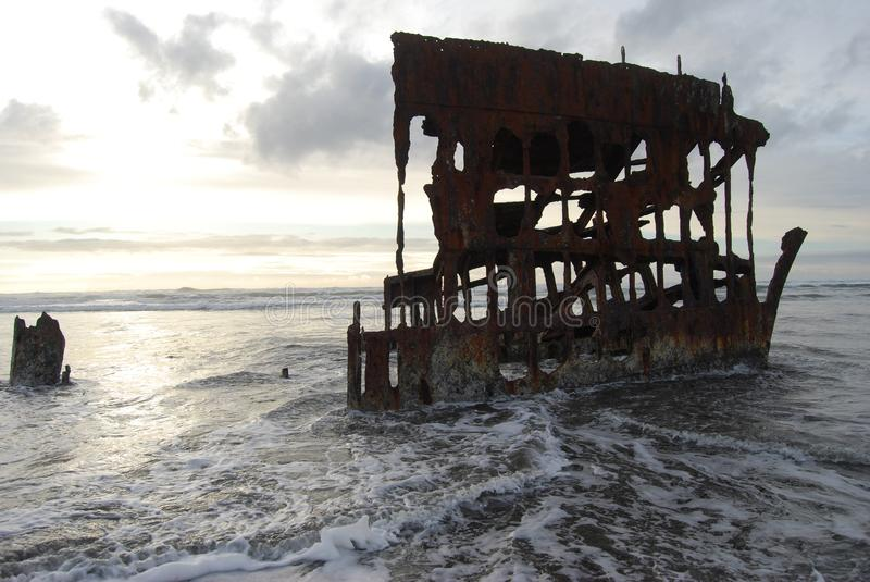 Wreck of the Peter Iredale. Current remains of the ship wreck Peter Iredale a four-masted steel barque sailing vessel that ran ashore October 25, 1906, on the royalty free stock photo