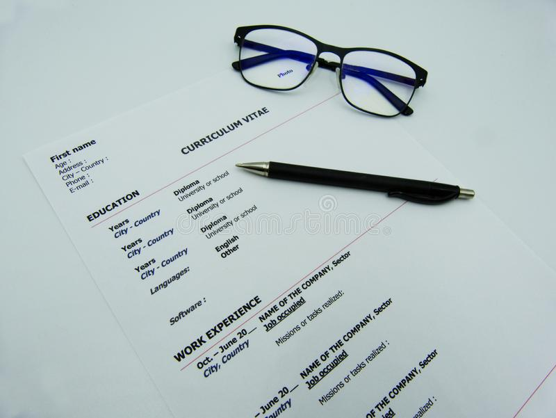 Curriculum Vitae concept on white table. Curriculum Vitae concept, pen and glasses royalty free stock image