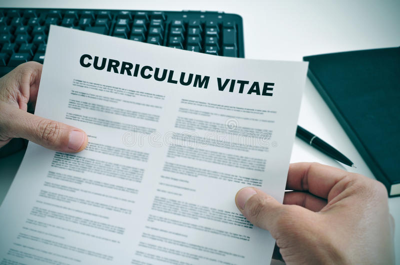 Curriculum vitae. Man in his office checking a curriculum vitae royalty free stock photography