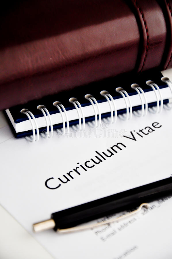 Curriculum vitae or resume. On a desk royalty free stock images
