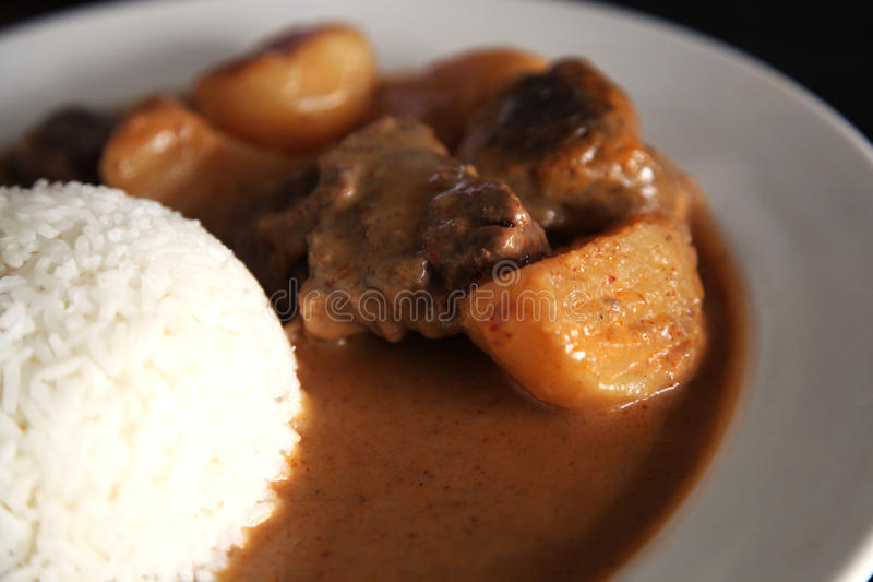 Curry beef with rice. And sauce royalty free stock photo