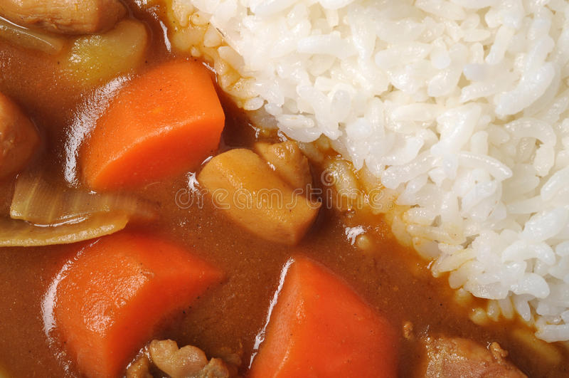 Curry chicken with rice. Background stock photo
