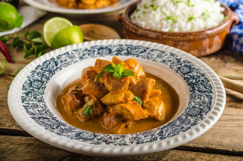 Curry chicken with rice. Curry chicken with basmati rice, delicious and spicy food, fresh herbs, very simple to make stock images