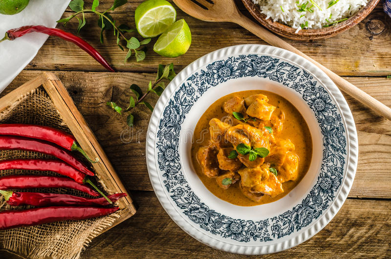 Curry chicken with rice. Curry chicken with basmati rice, delicious and spicy food, fresh herbs, very simple to make royalty free stock image