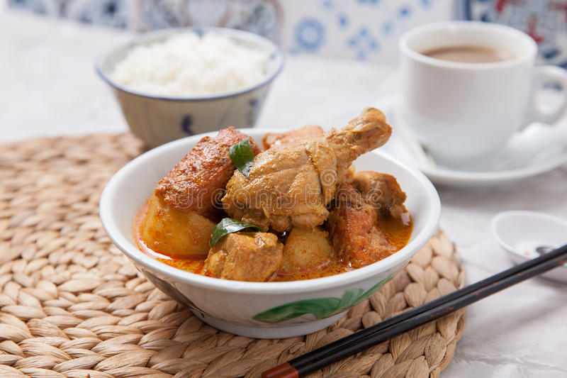Curry chicken with rice and coffee royalty free stock image