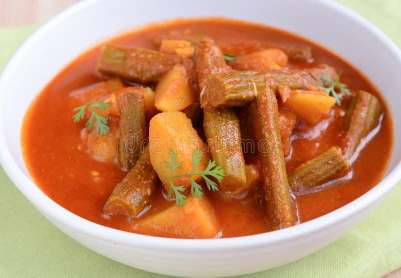 Curry de la patata del palillo imagen de archivo