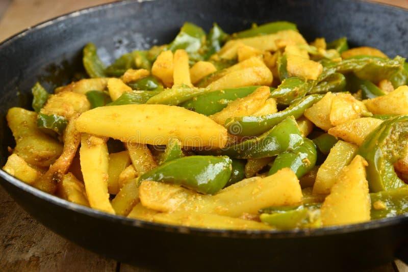 Curry del capsico della patata immagini stock
