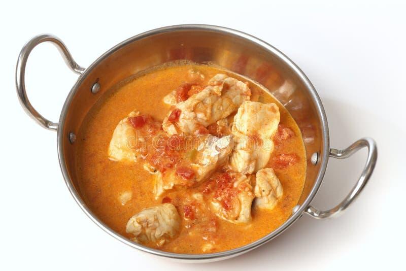 Curry del pesce in un kadai da sopra fotografia stock