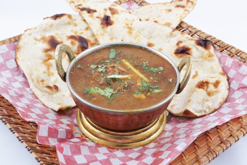 Curry della carne di capra con naan fotografie stock