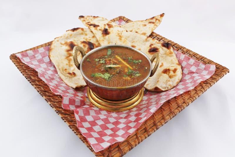 Curry della carne di capra con naan immagini stock