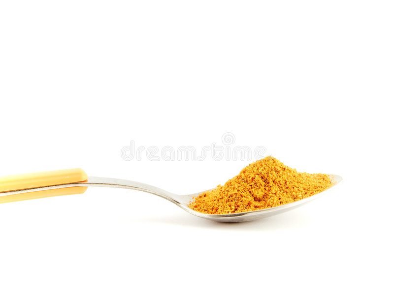 Curry e cucchiaio immagine stock