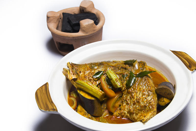 Curry of fish head with eggplant and traditional charcoal grill stock images