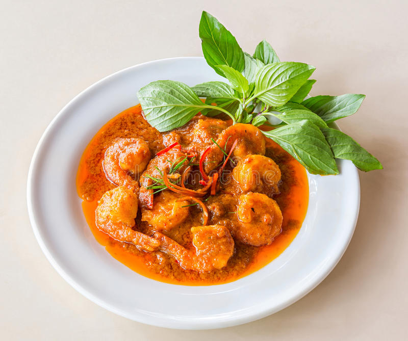 Curry fried shrimp. Or prawn with coconut milk and Kaffir lime leaf royalty free stock photo
