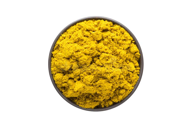 Curry i lerabunken som isoleras på vit bakgrund Seasonin arkivbild
