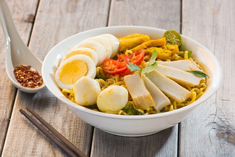 Curry Laksa som är ett populärt traditionellt arkivfoto