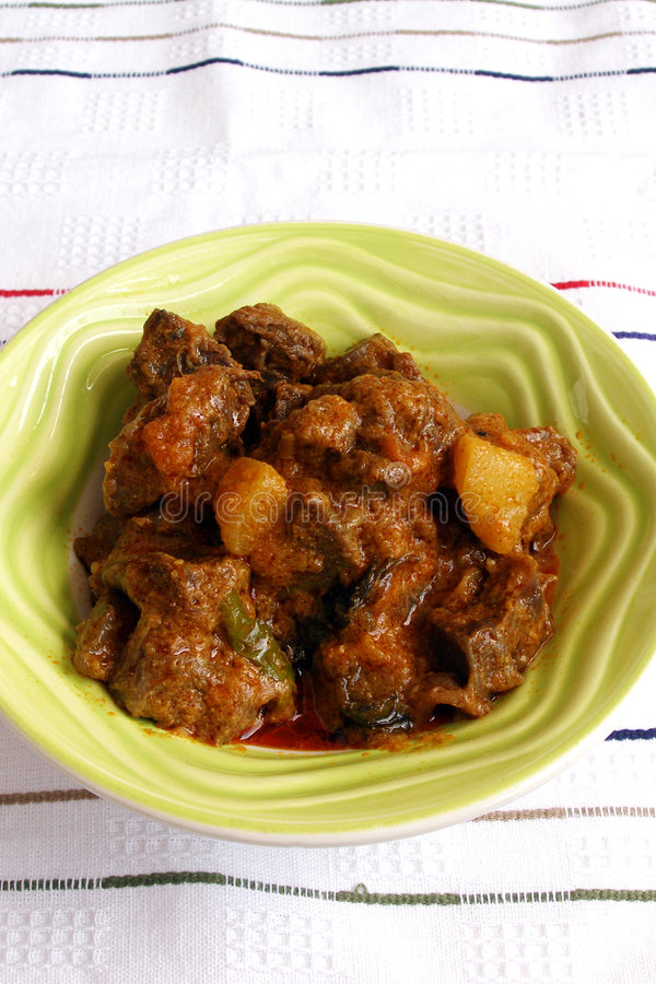 Curry lamb ethnic indian food. Curry main course for meal! - A dish of aromatic Indian spicy lamb or mutton curry, a well known food cooked with indian spices royalty free stock photography