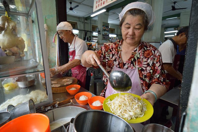 Curry Mee Stall. Curry Mee is a dish that is unique to Malaysia and Singapore, drawing from Malay, Chinese and Indian influences. It is usually made up of thin royalty free stock photos