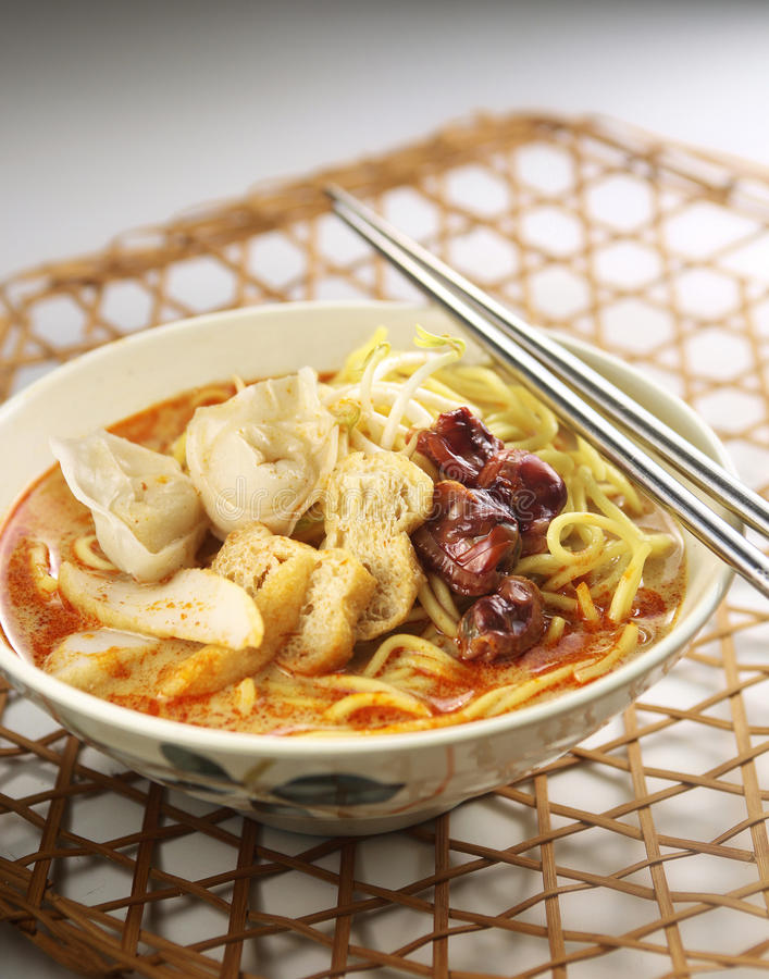 Curry noodle. With nice table setting stock photo