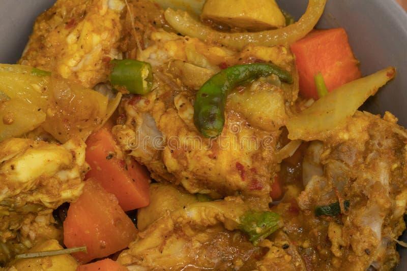 Curry piccante del pesce e dei peperoncini rossi immagini stock