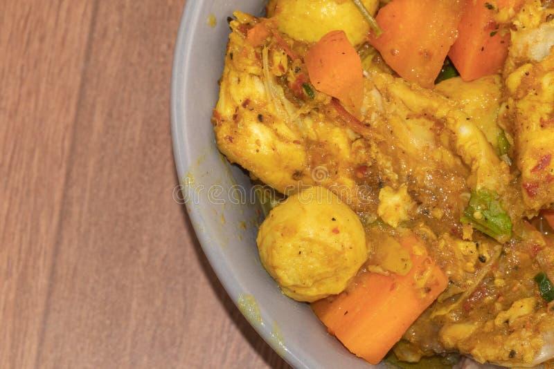 Curry piccante del pesce e dei peperoncini rossi fotografia stock libera da diritti
